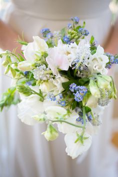 Spring bouquet of forget me Nots, muscari and very early sweet peas