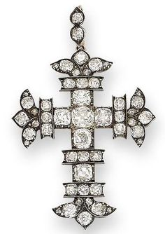 An early 19th century diamond cross pendant, circa 1820 The cross fleury set throughout with cushion-shaped diamonds, mounted in silver and gold, diamonds approximately 9.00 carats total