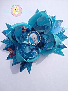 e7a39d7acc87f0 A beautiful Frozen inspired hair bow with turquoise glitter ribbon
