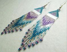 Made for pierced ears, these handmade Native American Inspired seed beaded earrings hang down 3 1/2 inches from the bottom of the French hook, and are about 3/4 inch wide. Nice swing to them, and are very lightweight to wear. The seed bead colors are Teal, Light Turquoise blue and Amethyst purple and Light Amethyst purple.  The only other beads used are Silver bugle beads.  These earrings shine and give just the right amount of bling.    Native American Inspired design. See My Profi...
