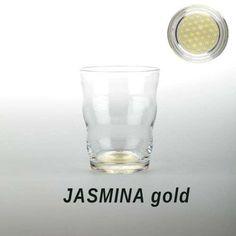 Bicchiere in cristallo con il fondo incorporato il fiore della vita in oro che informerà e riattiverà l'acqua in essa contenuto in pochi secondi