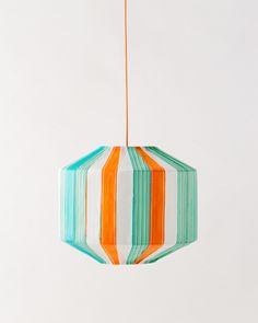 Suzie by Colonel. Plastic bands from american 60's camping chairs are hand sewn around a metal structure. Each lamp has a color harmony which can not be reproduced. It's form recalls the lantern, as its light.