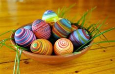 wrap hard boiled eggs with elastic rubber bands then put it in the food-coloring dye. remove them and pat dry with paper towel and remove the rubber bands.