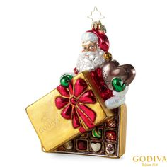 Our limited edition Christopher Radko® ornamen  featuring Santa enjoying a holiday favorite – a #GODIVA Holiday Ballotin.