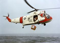 """Sikorsky HH-52 Seaguard - U.S. Coast Guard Sikorsky HH-52A Seaguard helicopter (s/n 1364) with a rescue basket. """"Although the rescue basket and hoist had been developed and put into use by the time the HH-52 entered service the Coast Guard did not have the trained personnel to actually jump in the water to assist injured or incapacitated survivors."""