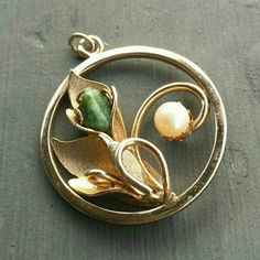 "Vintage Sarah Cov Pendant - 60s Dainty goldtone pendant designed by Sarah Coventry. The goldtone finish is in good condition. Lovely green stone and faux pearl accent this floral motif pendant. The details on the leaves and overall are beautiful. 1 1/2"" Vintage Jewelry Necklaces"