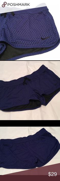"""Nike Reversible Shorts NWT Large💝 Nike Women's Reversible Training Shorts Brand new with tags. Size Large.  ExtraSoft jersey fabric on one side and large exaggerated mesh on the reverse.  These have a drawstring waist. See all pictures. No trades. No holds. All offers (lowest ?'s) via make """"offer"""" button please (reasonable offers). Thanks for looking and Happy Poshing! It was hard to capture the true color of these.  They are a bright bluish purple like color in my opinion and black on the…"""