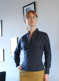 creating a kimono sleeved knit top withcurved neckline, stand up collar and peats from the neck to the bust! Love it!!
