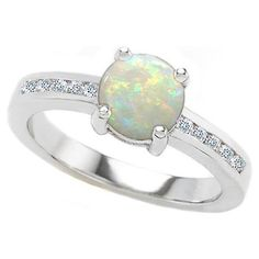 Opal engagement rings, a great alternative to that old diamond ring that every one gets.