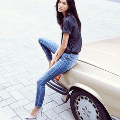 Tone down a ladylike blouse and light suede pumps with a light wash denim.