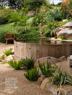 Never been interested in a pool, but this rustic oversized hot tub looks great.