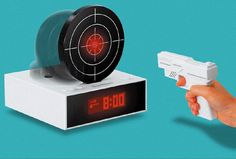 Bandai Gun O'clock Alarm Clock - The only way to turn the alarm off is by aiming at the upright target with the private pistol. Shoot at least 3 times and the loud beeping alarm will shut off. $89.99. Tristan def needs this !
