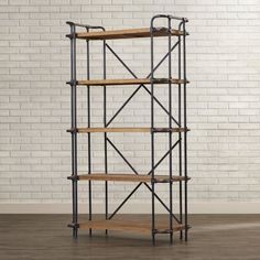 The Brookshire 5 shelf bookcase is built in the classic industrial furniture look. Built from hardwood and metal, this bookcase gives you the style while maintaining that rustic solid built look. The design adds that unique accent to any room you put it in.