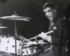 Buddy Rich, playing his Slingerlands. Dig the reverse angle on his snare drum -- and the totally flat cymbals!