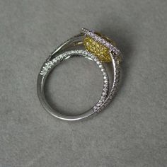 A Fancy Yellow Diamond and Platinum  Ring   From a unique collection of vintage engagement rings at http://www.1stdibs.com/jewelry/rings/engagement-rings/