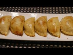 The pastry of these beautiful pasties are done with potatoes. They are so soft and moist. When you roll make sure to roll very thin. The mixture can be eithe. Finger Foods, Baked Potato, Berries, Rolls, Potatoes, Bread, Baking, Vegetables, Corner