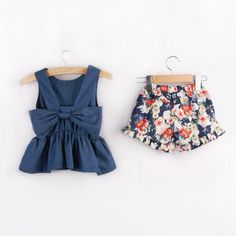 * Sweet bowknot<br /> * Ruffled hem<br /> * Material: 95% Cotton, 5% Polyester<br /> * Machine wash, tumble dry<br /> * Imported<br /> <br /> This set consists of a sweet denim top and a floral shorts featuring ruffled hem for a pretty and sweet look.