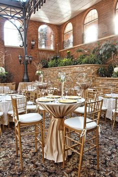 Love the hi-boy seating for a wedding reception, and the gold is gorg in this room!