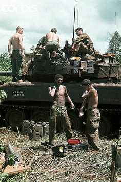 17 Oct Saigon, Vietnam- Members of the Armored Cavalry in the rubber plantation area at Loc Ninh and Quan Loi are shown after their arrival here. Some soldiers check out their tank as others in the foreground wash themselves off. Vietnam War Photos, North Vietnam, Vietnam Veterans, Vietnam Travel, Saigon Vietnam, Dalat Vietnam, American War, American History, History