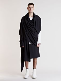 Can't say no to a man in a skirt. Or in a pancho/wrap/scarf thing. Created by Thamanyah