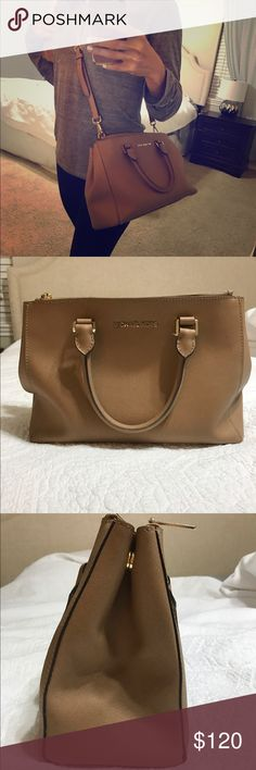 Michael Kors- Sutton Satchel Bag dimensions: 9 inches high x 13 inches wide x 5 inches deep Drop: 4-inches Additional shoulder strap drop: 20-inches- Very Clean purse and still a lot of life left. Michael Kors Bags Crossbody Bags