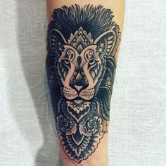 Black Lion Head Tattoo with Ornaments in Dotwork Style