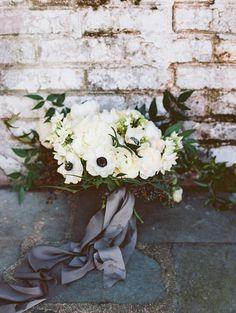white bouquet with anemones - photo by Adam Barnes http://ruffledblog.com/organic-greenhouse-wedding-inspiration #weddingbouquet #flowers #bouquets