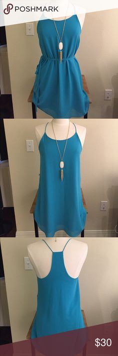 Teal Blue Naked Zebra Dress Super cute naked zebra dress in size Small. Only worn once. Can be worn with or without belt. Ask all questions prior to purchase •  bundle to save •  willing to consider any reasonable offer  <3 Naked Zebra Dresses Mini