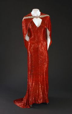 Costume designed by Adrian for Joan Crawford in The Bride Wore Red (1937).
