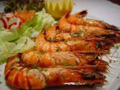 Poêlée de Gambas, riz Pilaf & sauce crustacés