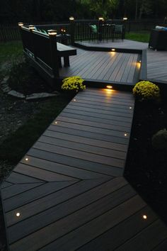 This more modern outdoor lighting makes a wood finish patio in a shabby chic garden look elegant. #shabbychichomesexterior
