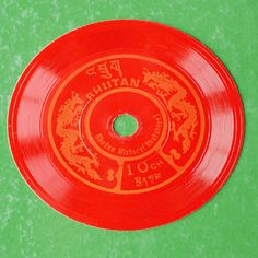 """""""Playing"""" postage stamps. Bhutan, the country in the eastern Himalayas, emitts stamps that are gramophone records. When playing this kind of disc–stamp one can listen to folk songs and the national anthem of this Asian country."""