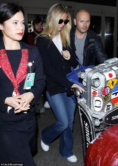 Casual chic: Gwyneth Paltrow, 43, ditched the heels and went for comfort as she arrived at LAX airport on Wednesday