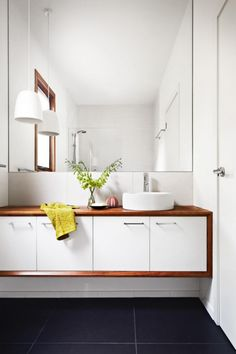 8 white and timber bathroom ideas: http://www.insideout.com.au/renovations/bathroom/light-and-bright-white-and-timber-bathrooms. Styling by Julia Green. Photography by Armelle Habib.