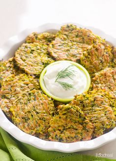 Baked Zucchini Fritters made healthier with whole wheat flour and baked instead of fried. Same crispy zucchini fritters without oil.