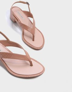 719767d9fb97 Nude thong sandals featuring a slingback strap and a low block heel.