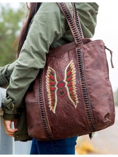 58d9971307b1 The Eagle Tote Brown handbag by Old Gringo. Brown color with Eagle beads  handmade details. Zipper closure and dust bag for safe storage.