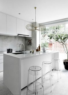 modern white kitchen + acrylic stools