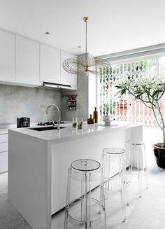 white kitchen + acrylic stools