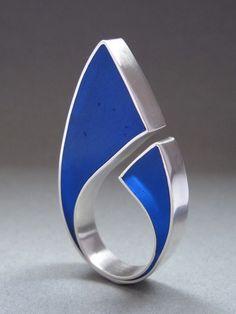 http://www.etsy.com/listing/62949543/huge-blue-sterling-silver-resin-ring?ref=v1_other_1