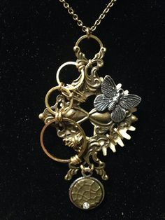 Steampunk pendant with rings and butterfly