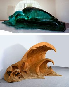 """Glass and Wood wave sculptures by Mario Ceroli. Italian artist Mario Ceroli created these two giant wave sculptures back in 1992. """"Maestrale"""" is made of sea green cross-sections of glass. """"La Vague"""" was crafted from sections of fir wood. According to the New York Times, 74-year old Ceroli """"is one of the least known but most influential artists of the Italian post-war scene."""""""