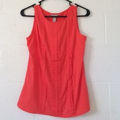HPBanana Republic Pleated Sleeveless Top Style Obsessions Party - 12/13/15 A beautiful sleeveless top by Banana Republic in a gorgeous shade of coral. Perfect to wear to the office under a blazer! Only worn a few times; in perfect condition. NO TRADESNO PAYPALNO LOWBALLING I'm willing to negotiate via the Offer button Banana Republic Tops Blouses