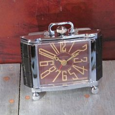 Featuring an authentic deco style Arabic dial, the Pendulux Richmond Alarm Clock stands eclectic and assertive with alligator leather accents and a heavy nickel plate finish body.