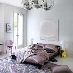 Romantic bedroom with satin bed linen and disco ball lights