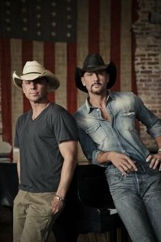 Kenny Chesney & Tim McGraw the perfect combo...I can look at Tim while Kenny sings to me...