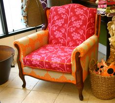 This wonderful big armchair had been rescued and reborn in a celebration of color. Wood detail on the arms and back anchor our Grande Fleur fabric in Tangerine on the sides and back and Blossom in Crimson/Passion on the seat and front with Tangerine trim.