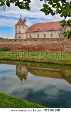 Fagaras fortress with reflection - stock photo