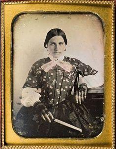 ca. 1849, [daguerreotype portrait of Miranda Adkins Sneed in a fine dress and lace gloves]