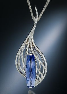 Regal and resplendent. Scintilla pendant showcases a tanzanite in white gold with diamond pavé.